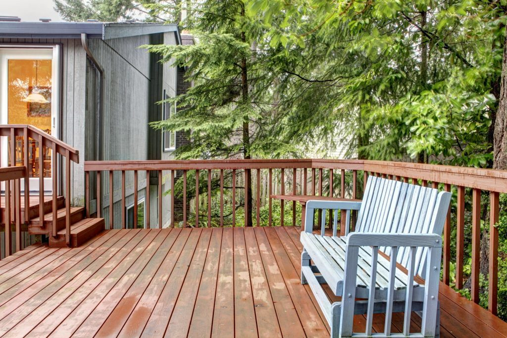 deck made out of wood and trees around it