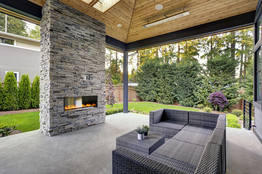 modern house with covered patio and bricked chimney