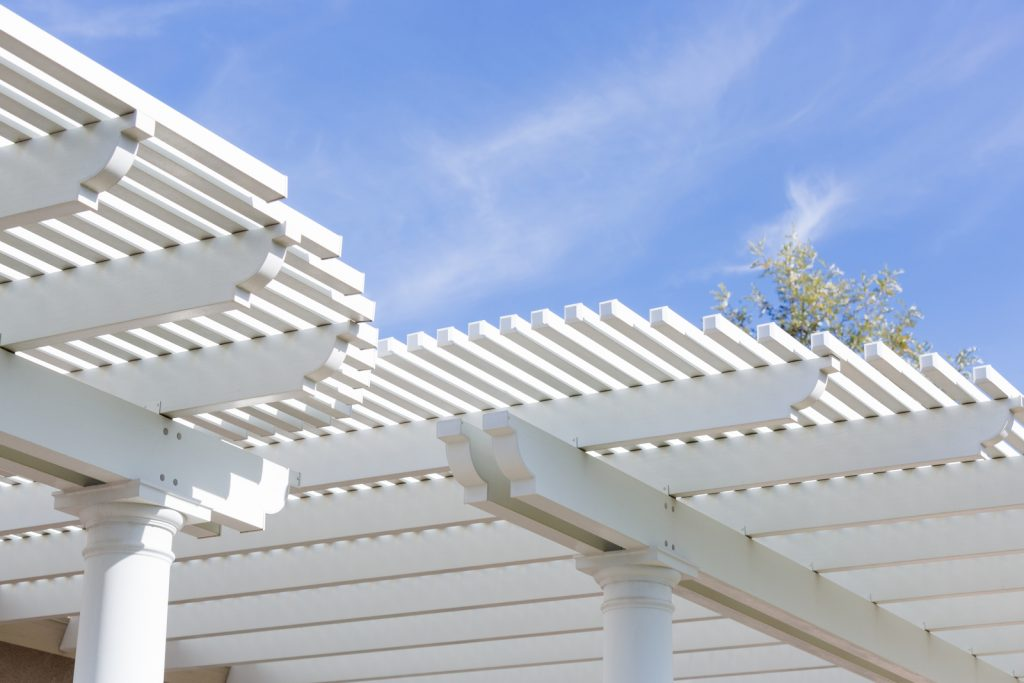 white wood pergola and white posts