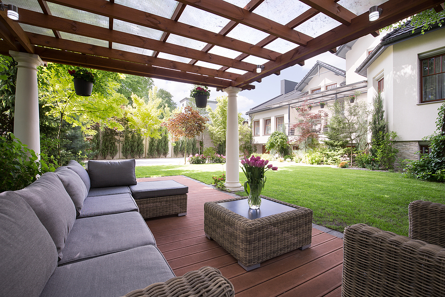 covered patio with wood floor and furniture